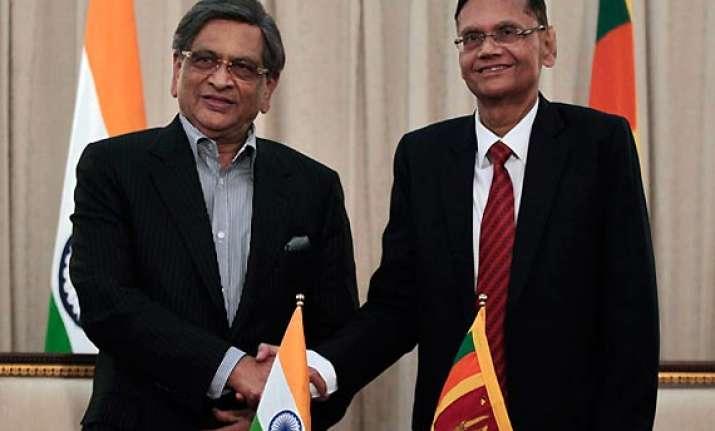 lanka fm requests krishna to re consider vote on un