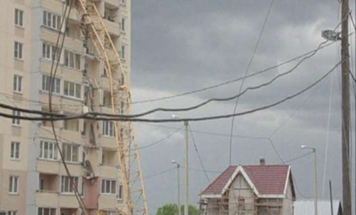 large crane collapses on apartment building in russia