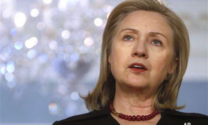 leave libya as soon as possible clinton tells gaddafi