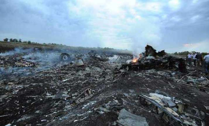 mh17 crash forensic experts gather material to identify