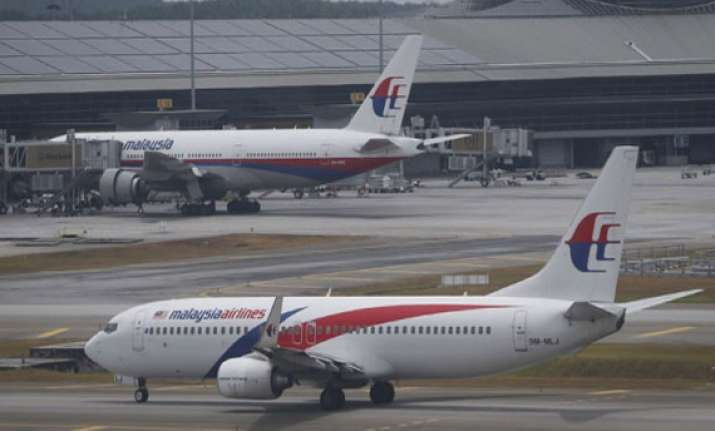 malaysian airlines flight to bangalore returns to kuala
