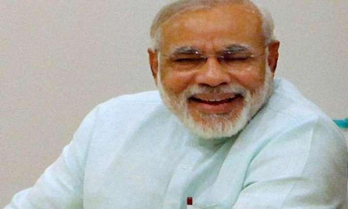 narendra modi gets invite to visit britain