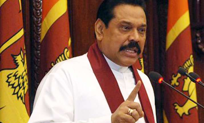 no one has to tell us what to do says rajapaksa