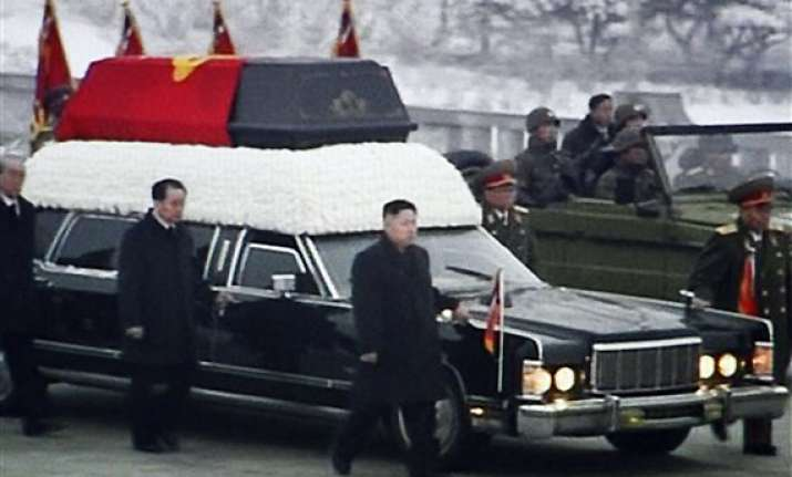 north korea bids wintry mass farewell to kim jong il