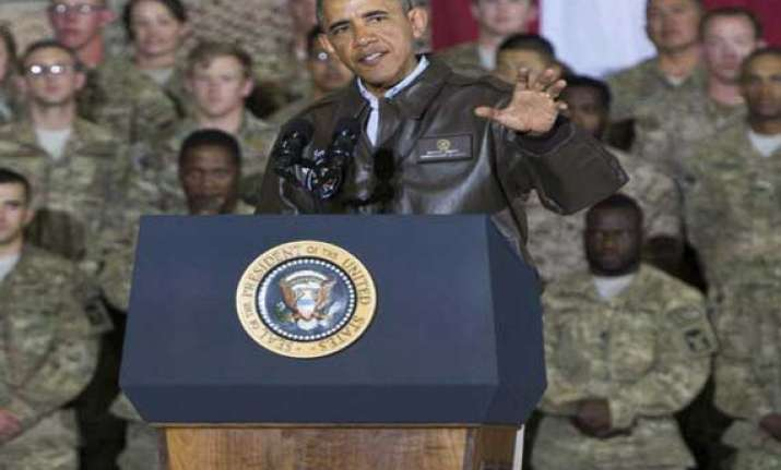 obama announces plan to leave only 9 800 troops in