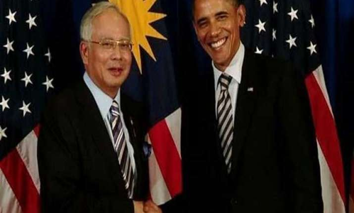 obama opens long awaited visit to malaysia