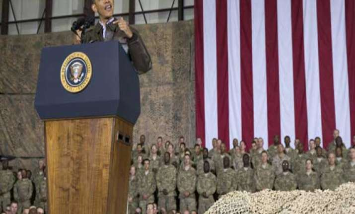 obama pays surprise visit to us troops pledges responsible