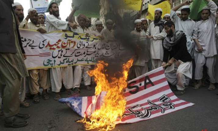 obama apologizes over desecration of holy quran in