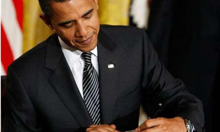 obama signs defense bill despite reservations