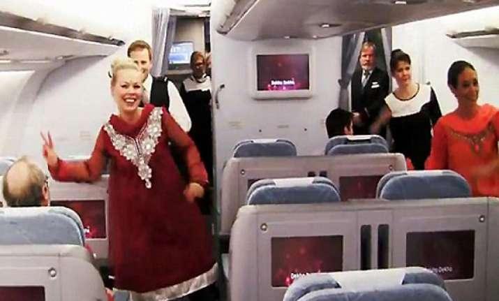 on helsinki delhi flight finnair cabin crew do the om