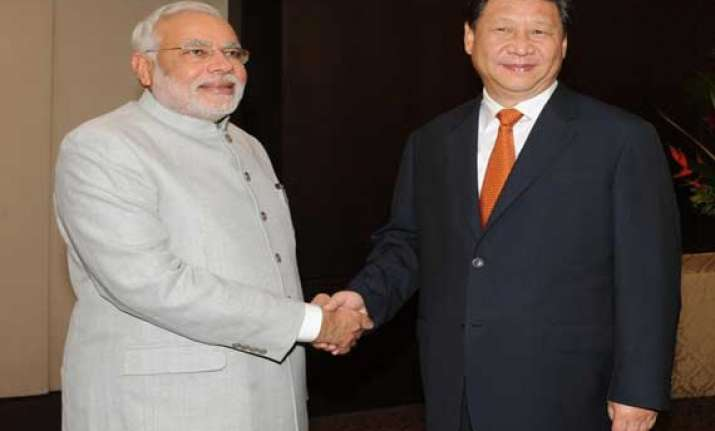 pm modi meets chinese president presses for solution to