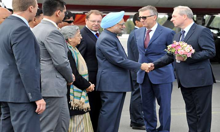 pm arrives in russia for bilateral talks