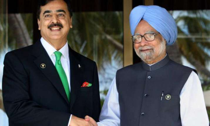 pm gilani greet each other at seoul summit