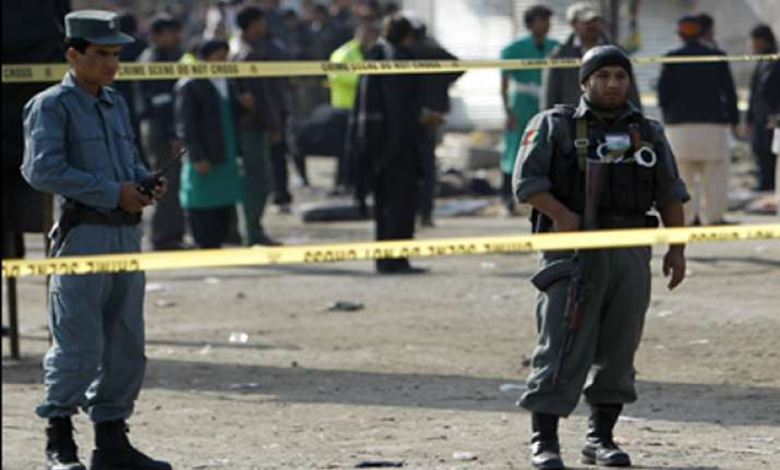 59 dead in afghan shrine blasts on shiite holy day