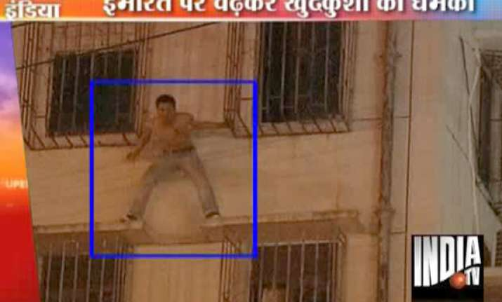 police abseil in to save suicidal man on window ledge in