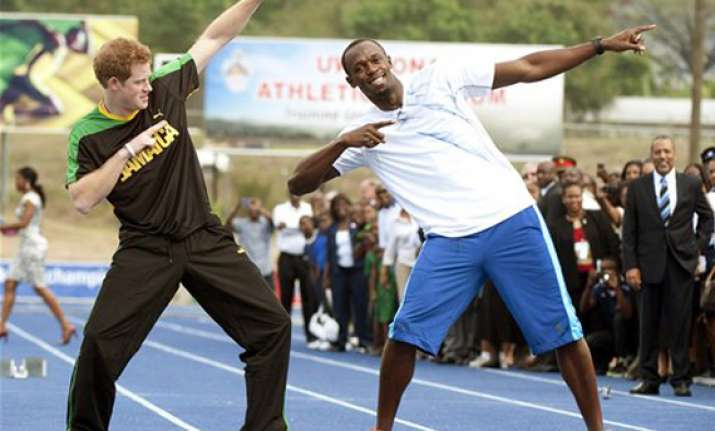 prince harry runs with usain bolt in jamaica