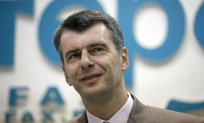 prokhorov russian tycoon to run against vladimir putin
