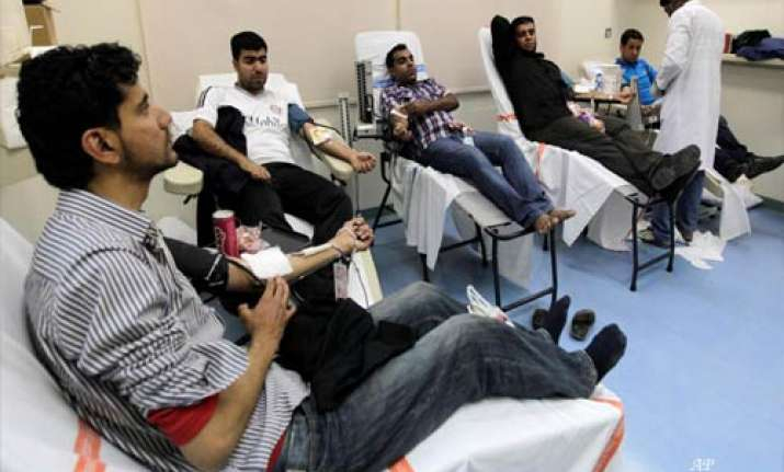 protesters help the wounded in bahrain hospital