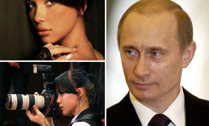 putin makes glamour girl his personal photographer