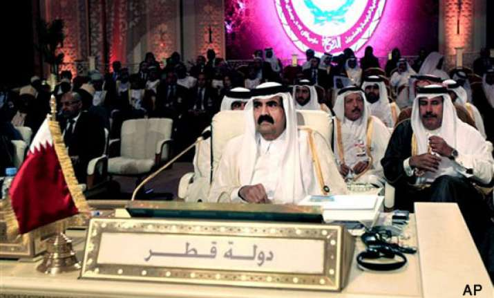qatar ruler hands power to son to mark new era