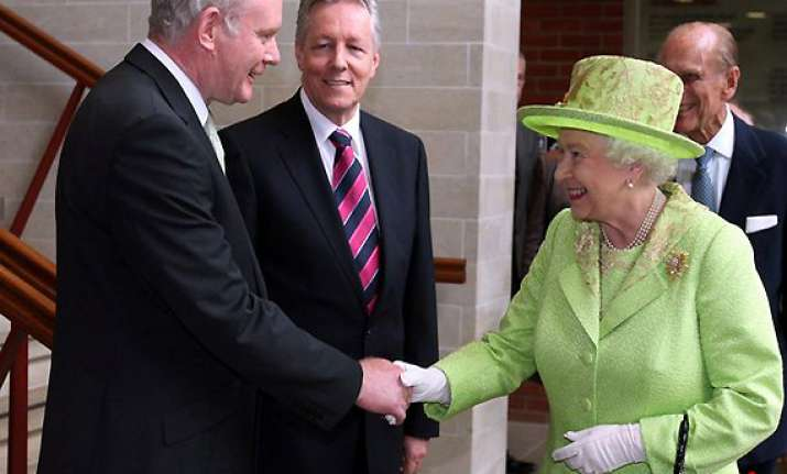 queen in historic handshake with her cousin s killer