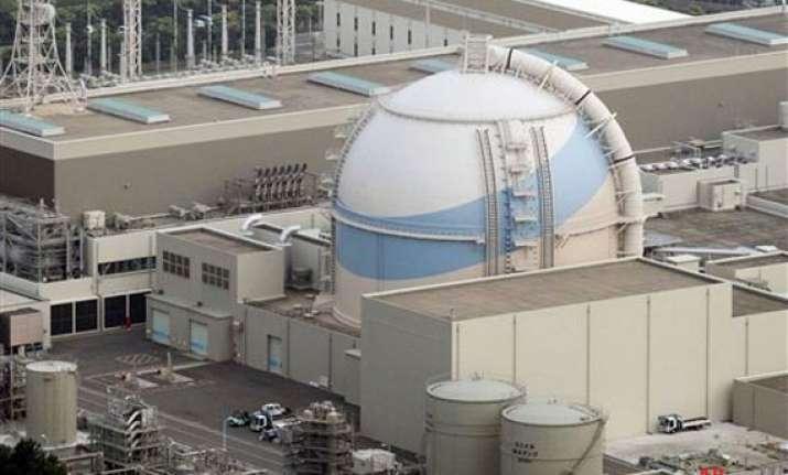 report radioactive water leaks inside japan plant