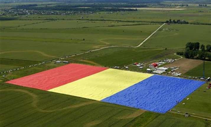 romanian village unfurls world s largest flag join guinness
