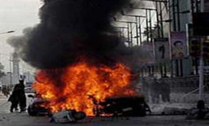 seven killed in peshawar as two suicide bombers attack govt