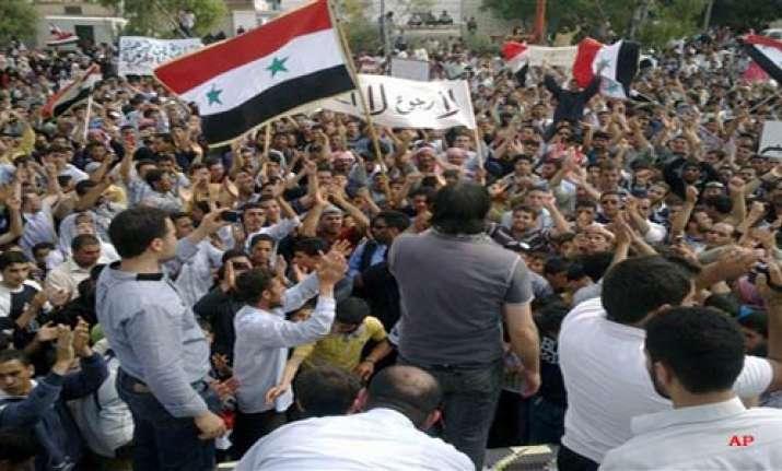 seven shot dead tanks circle syria towns activist