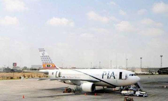 shots fired at plane landing in peshawar 1 killed 2 injured