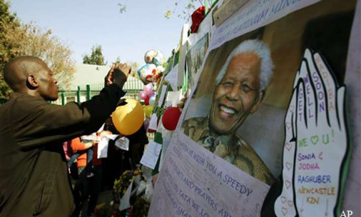 south africa mandela remains critical as family feuds
