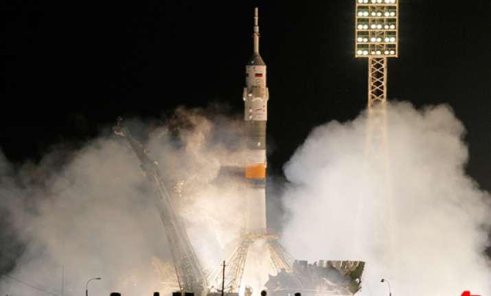 soyuz carrying russian american and dutch astronauts blasts