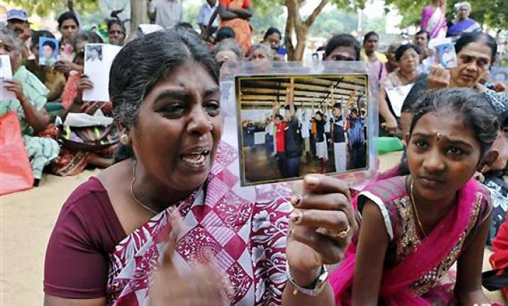 sri lanka arrests tamil woman who pressed case for war