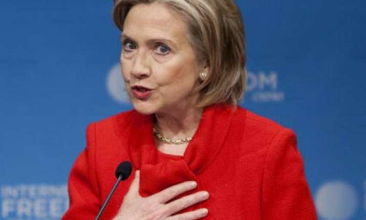 stop this unacceptable bloodshed in libya clinton