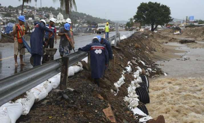 storm weakens off mexico coast still rain threat