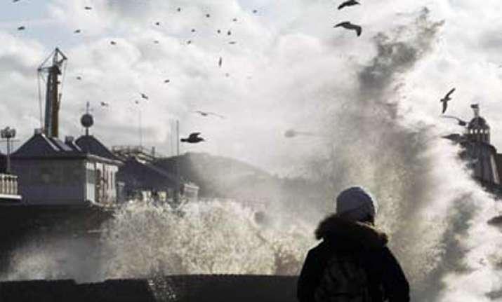 storms wreak havoc in britain leave two dead
