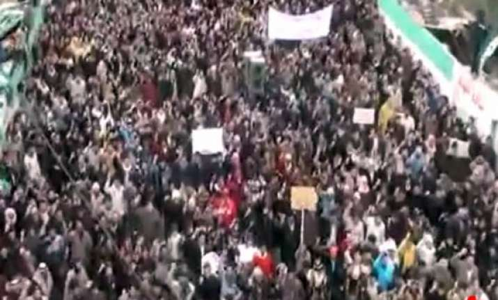 syria forces fire nail bombs as masses protest