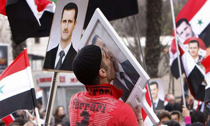 syria s assad makes rare appearance at rally