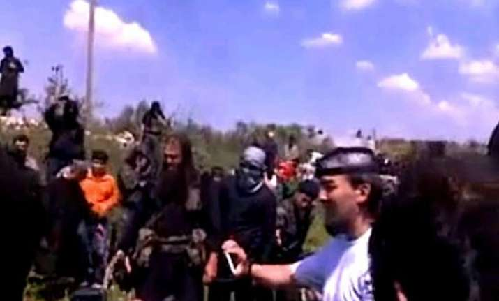 syrian video shows catholic priest beheaded by militants