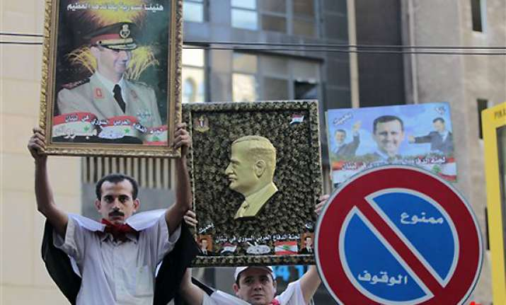 syrians protest arab vote embassies attacked
