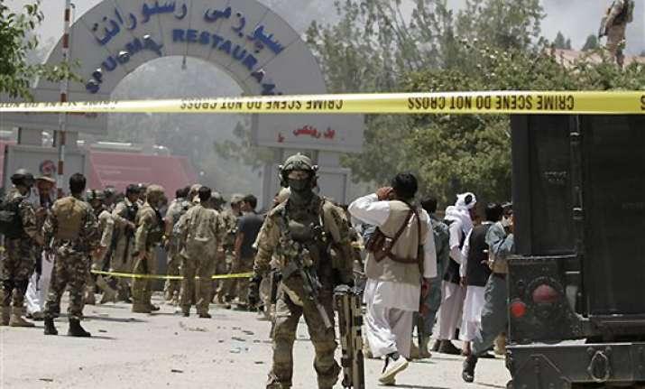 taliban storm afghan hotel killing 18 people