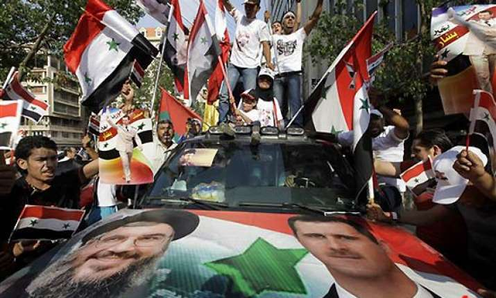tens of thousands rally in syria against assad troops open
