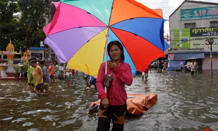thailand says floods may ease early next month