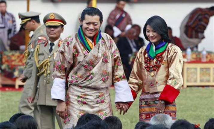 thousands greet bhutan royal couple on way to capital