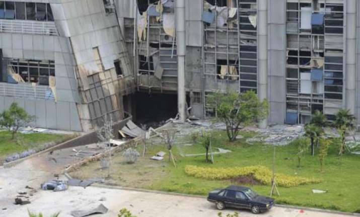 three dead in china building explosion