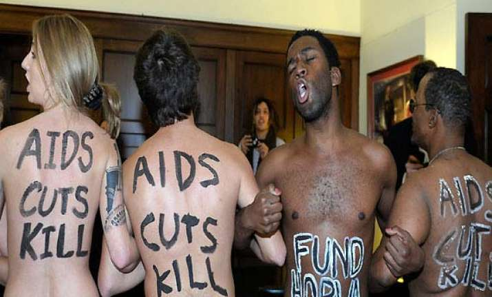 three female aids activists take off clothes in us speaker
