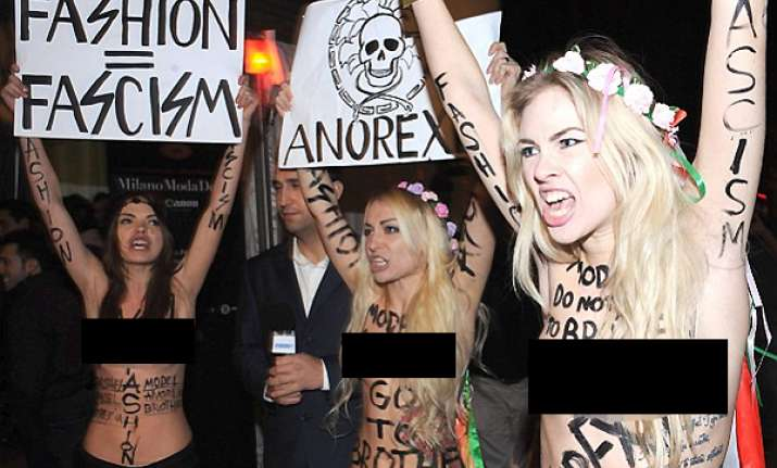 topless protesters crash milan fashion week in demo against