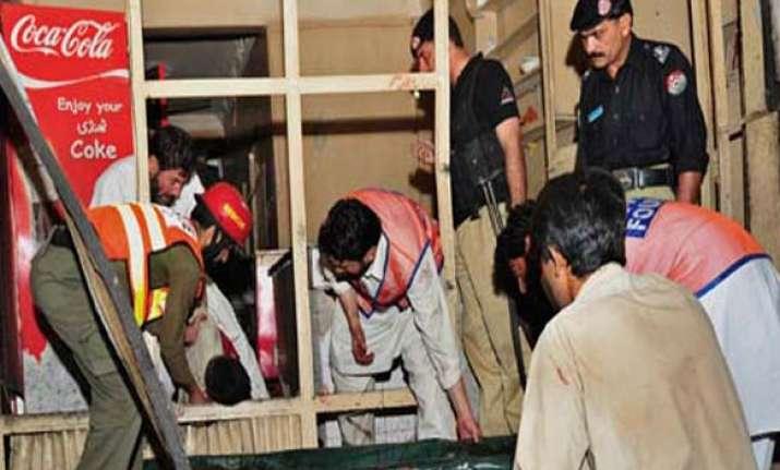 twin blasts kill 34 in pakistan