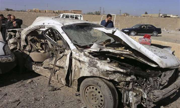 twin car bombs kill 11 in baghdad say police officials