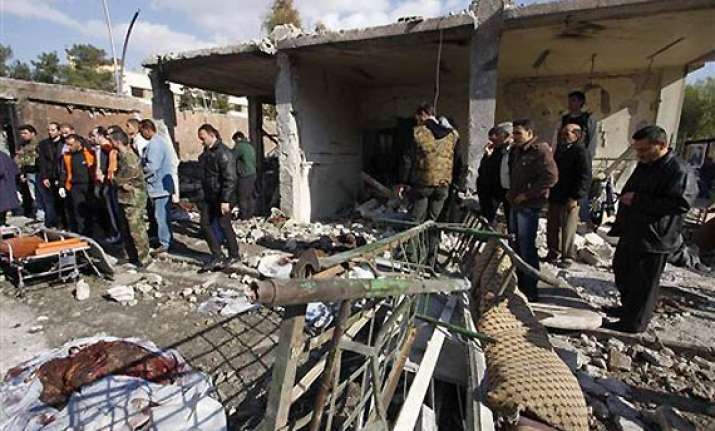 syria twin suicide bombs shake capital 40 dead